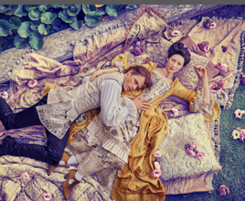 18th century grand costume-clad actors lying down